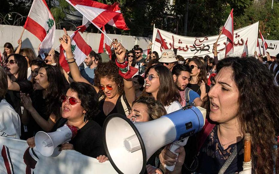 Demonstrators protesting for women's rights and against government corruption march through Beirut, Lebanon on November 3, 2019.