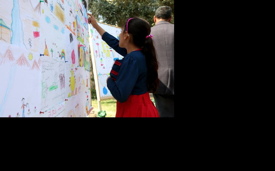 A child visiting the exhibition. (Photo: IWPR)