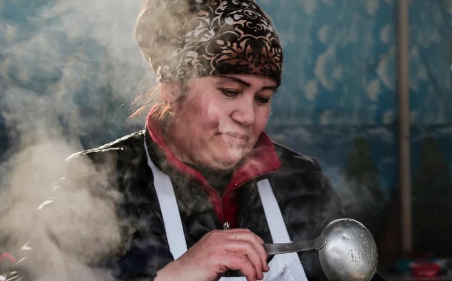 Firuza sells traditional Uzbek food at the market. She is saving her money to help pay for her granddaughters weddings.