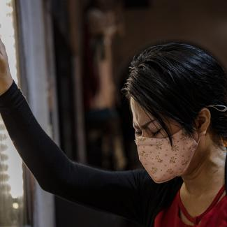 A woman wearing a facemask prays at a church on February 9, 2020 in Paranaque, Metro Manila, Philippines.