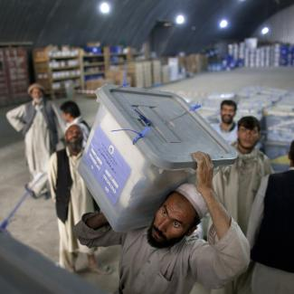 Workers shift ballot boxes at the Independent Election Commission warehouses on September 23, 2010 in Kabul.
