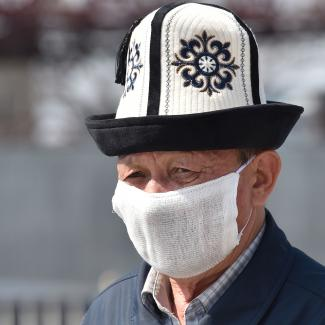 An elderly man in a Kyrgyz national hat wearing a face mask, amid concerns over the spread of coronavirus. Bishkek March 27, 2020.