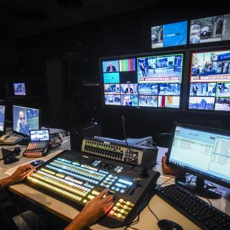 An editor wearing a face mask works in the control room at C5N news TV channel on April 17, 2020 in Buenos Aires, Argentina.