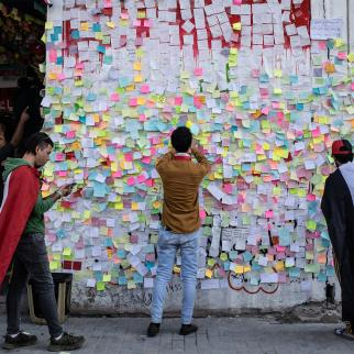 "Demonstrators paste wishes on post-it notes on the ""wish wall"" in Tahrir Square on Nov. 22, 2019 in Baghdad, Iraq."