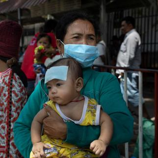 Cambodian children wait for medical care outside a hospital in Phnom Penh, Cambodia on February 12, 2020.
