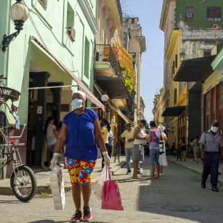 A shopper wearing a face mask walks in Old Havana.