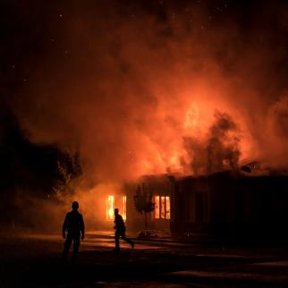 A fire burns in a hardware store after a rocket attack caused the building to catch fire on October 3, 2020 in Stepanakert, Nagorno-Karabakh.