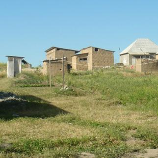 These mud-brick-built houses in Ak Jar are typical of the temporary squatter settlements that take on a permanent aspect over time. (Photo: Sabina Reingold)