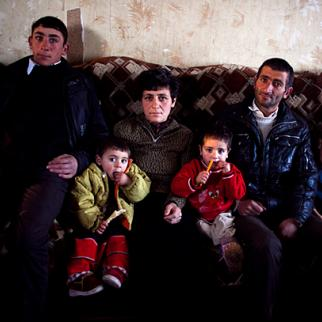 Silva Barkhoyan with her husband and six children. Photos like this prompted local government and an international charity to step in and help the family. (Photo: Inna Mkhitaryan)