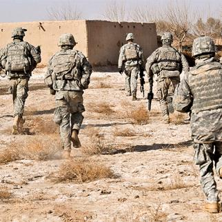 US soldiers advance on a civilian compound while responding to a Taleban attack in Helmand. When civilian casualties occur during the fighting, local resentment focuses on the foreign troops rather than the insurgents. (Photo: Tech. Sgt. Efren Lopez/US military)