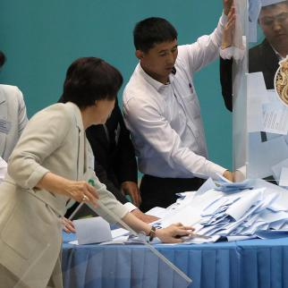 Members of the precinct election commission in Nur-Sultan are counting ballot papers during parliament elections held in Kazakstan at 10th January. (Photo: CABAR/IWPR)