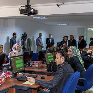 University of Tripoli students use the media lab work stations during the March 26 launch event for the media training facility. (Photo: Ibrahim El-Mayet)