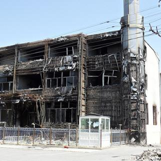 Southern Kyrgyzstan suffered serious damage in arson attacks during the June violence. This shell of a building is all that remains of a department store in Osh. (Photo: Pavel Gromsky)