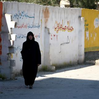 A woman walks in the Salah al-Din neighbourhood. (Photo: Syria Stories)