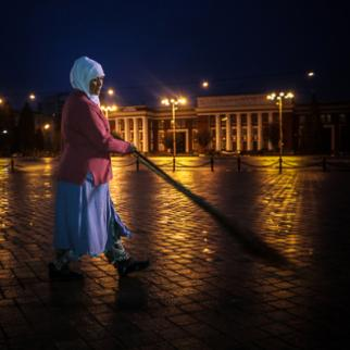 A street cleaner begins her working day at half past three in the morning outside the parliament building in Dushanbe. (Photo: Lidia Isamova)