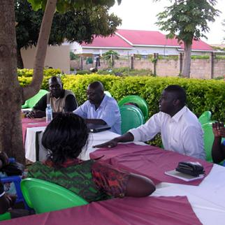 Listeners to IWPR's Facing Justice programme debate the importance of war memorials and establishing a record of the conflict in northern Uganda. (Photo: IWPR)