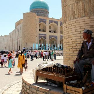 In the old city of Bukhara, a man sells a traditional device for making bread. (Photo: Government tourism portal: uzbekistan.travel)